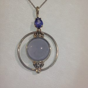 14 Kt Yellow and White Fold Tanzanite and Blue Chalcedony Pendant